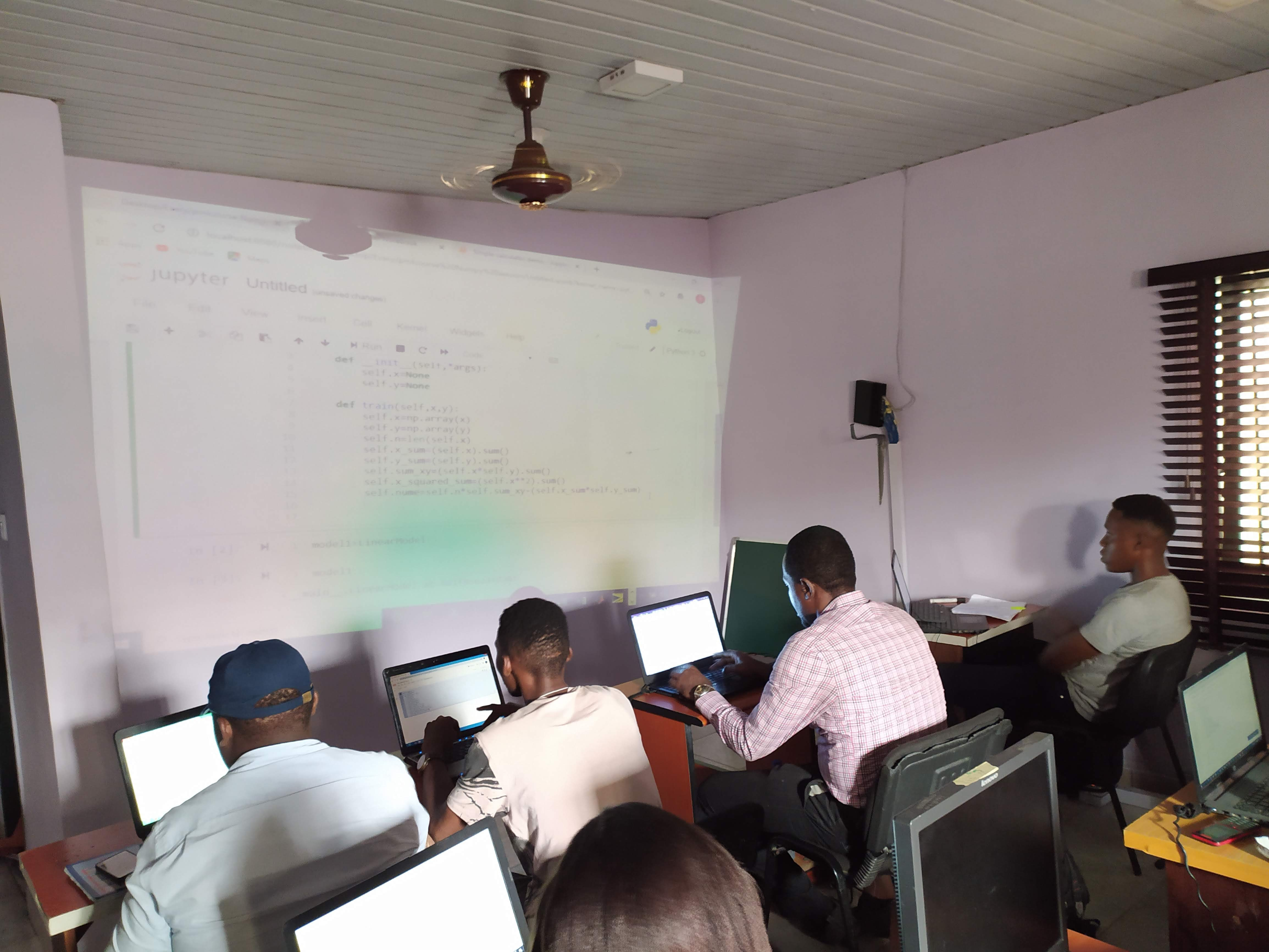 Students writing code on their computers