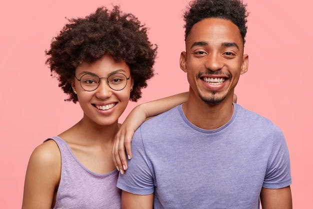 horizontal-shot-happy-african-american-woman-man-have-truthful-relationships-toothy-smile-happy-meet-with-friends-dressed-casually-isolated-pink-wall-emotions-concept_273609-15558.jpg