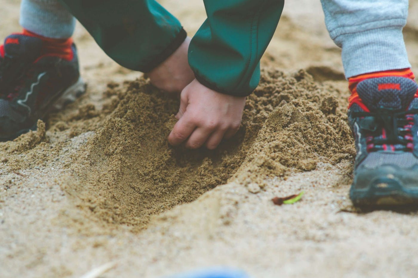 Kid digging in the sand
