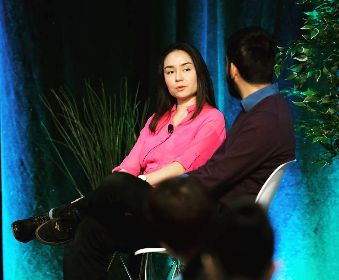 Tina Holly speaking with moderator Aaron at a panel at Geeky Summit in Calgary