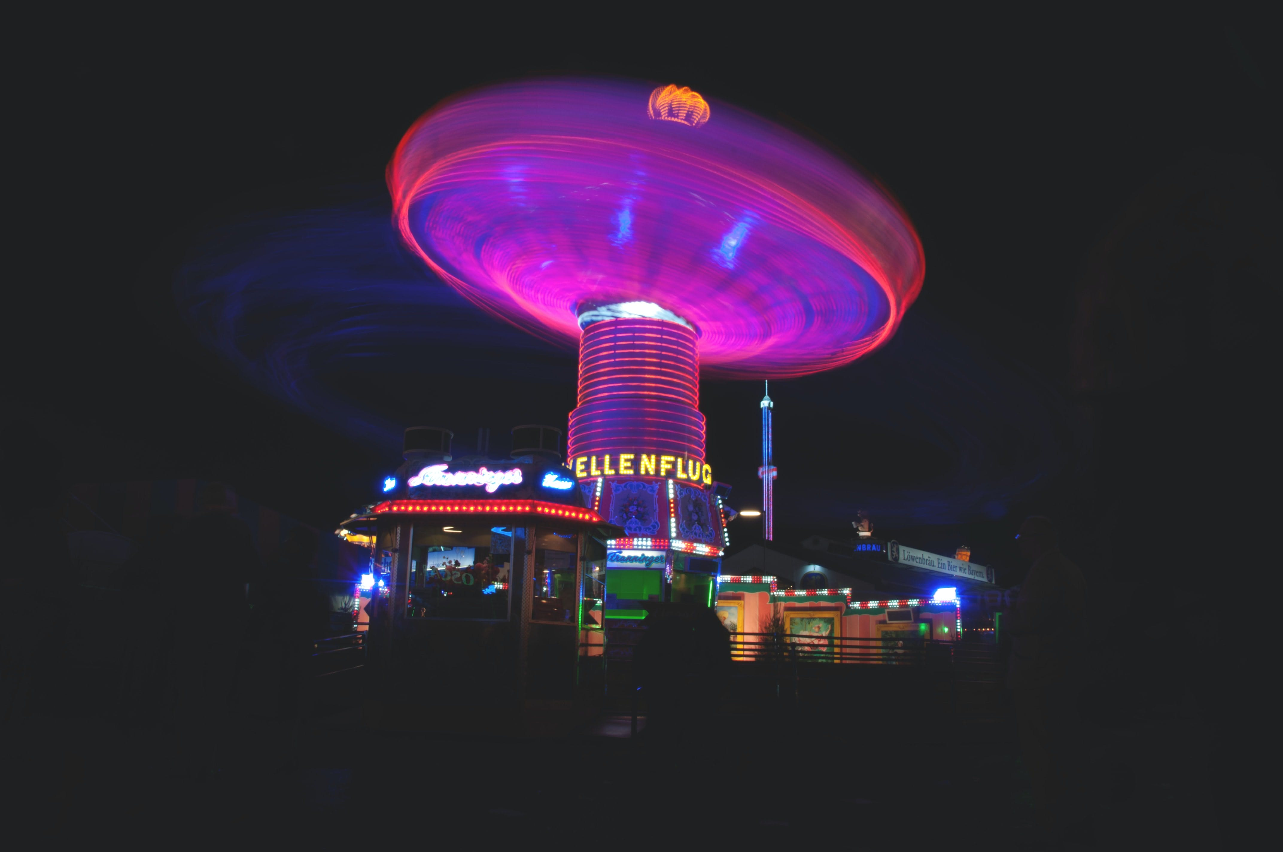 photo of amusement ride at oktoberfest during the nighttime hours