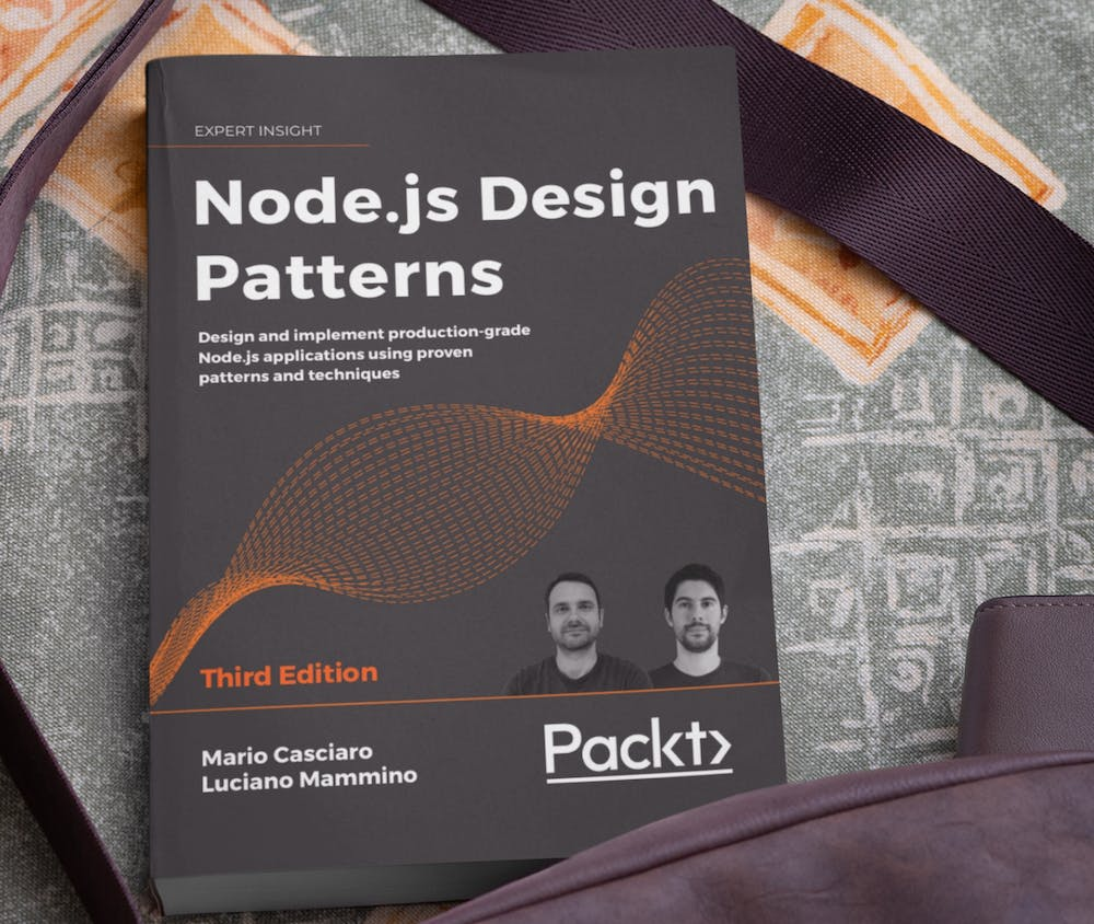 Node.js Design Patterns, the book on a table