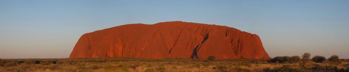 Uluru at dusk. Image by Stuart Edwards from Wikimedia Commons.