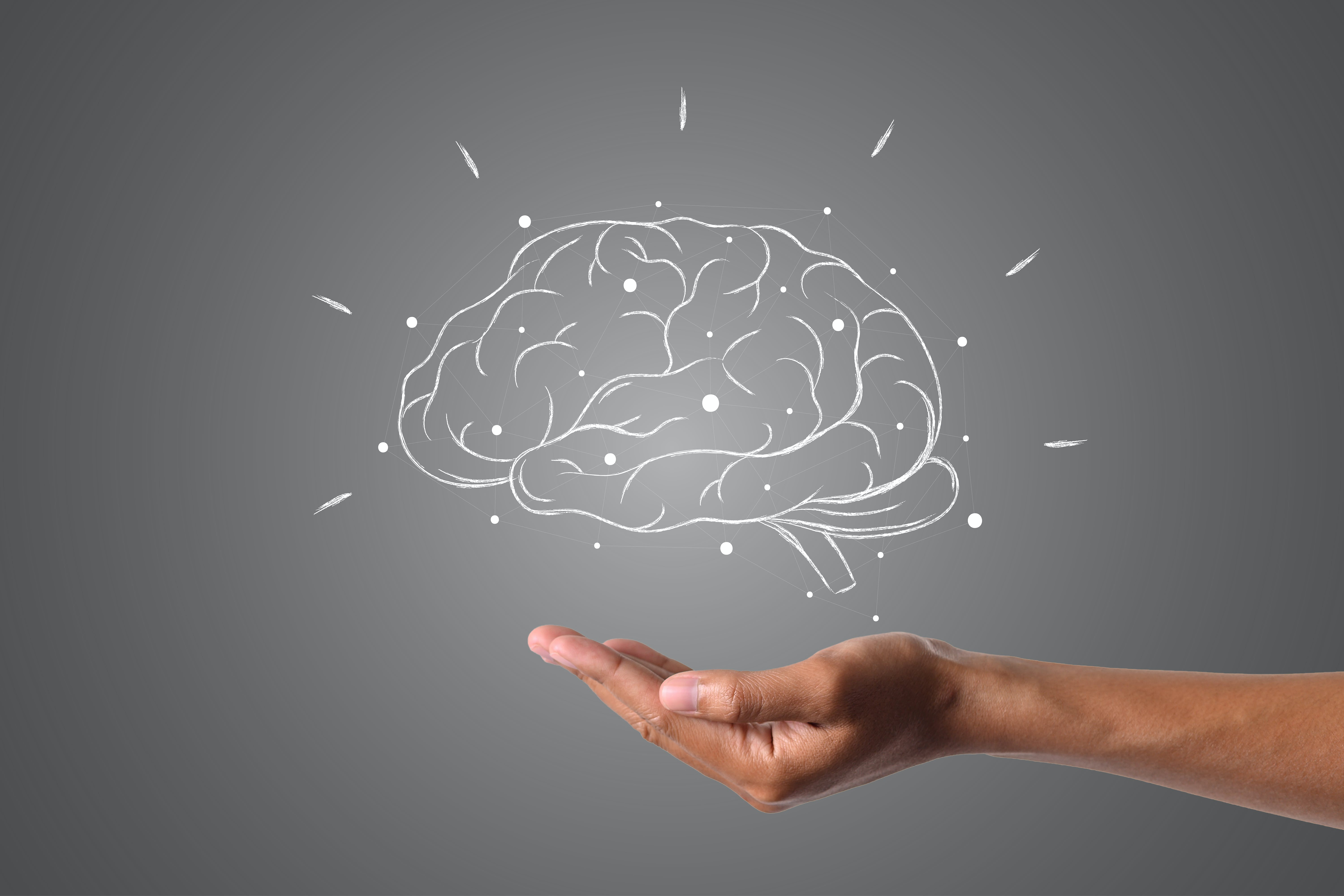brain-writes-with-white-chalk-is-on-hand-draw-concept.jpg