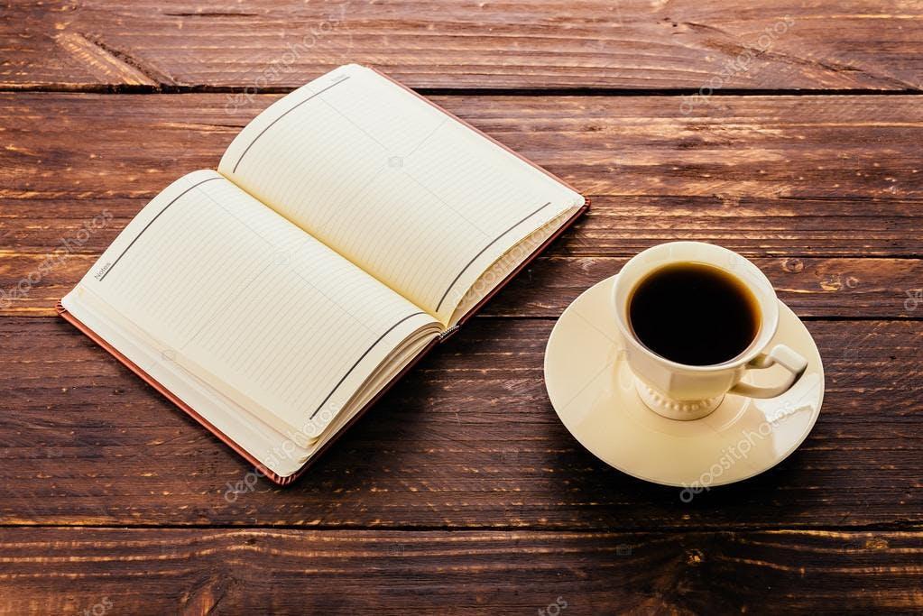 depositphotos_63098395-stock-photo-coffee-cup-and-book.jpg