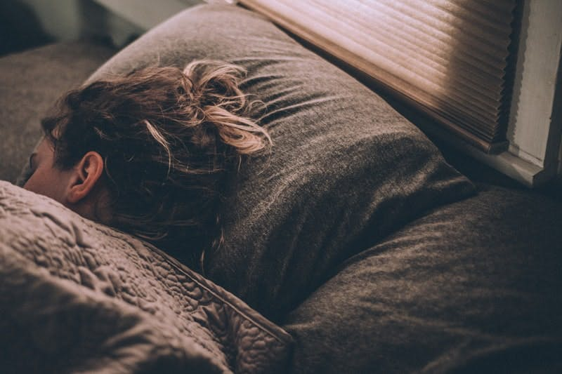 a-woman-sleeping-in-bed.jfif