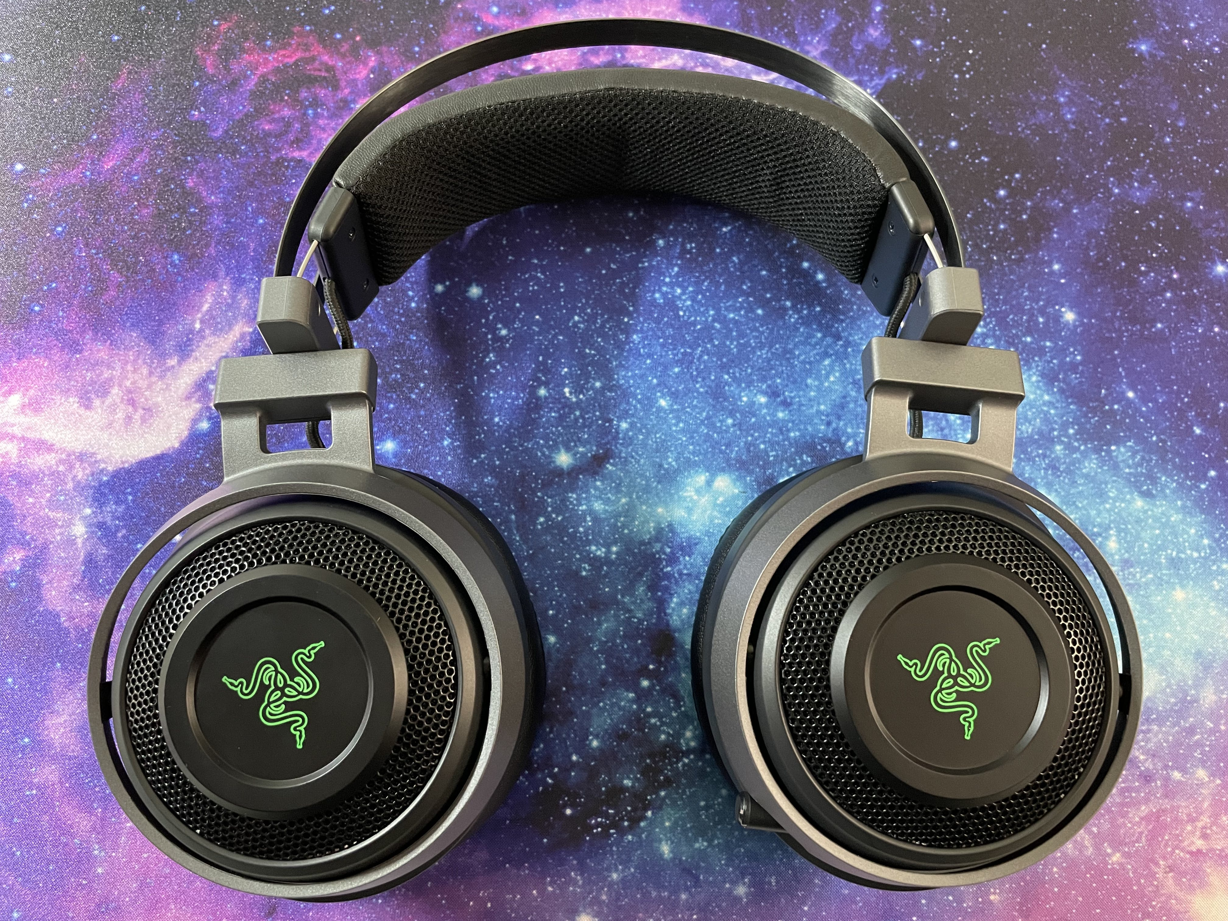 A Razer gaming headset with green logos.