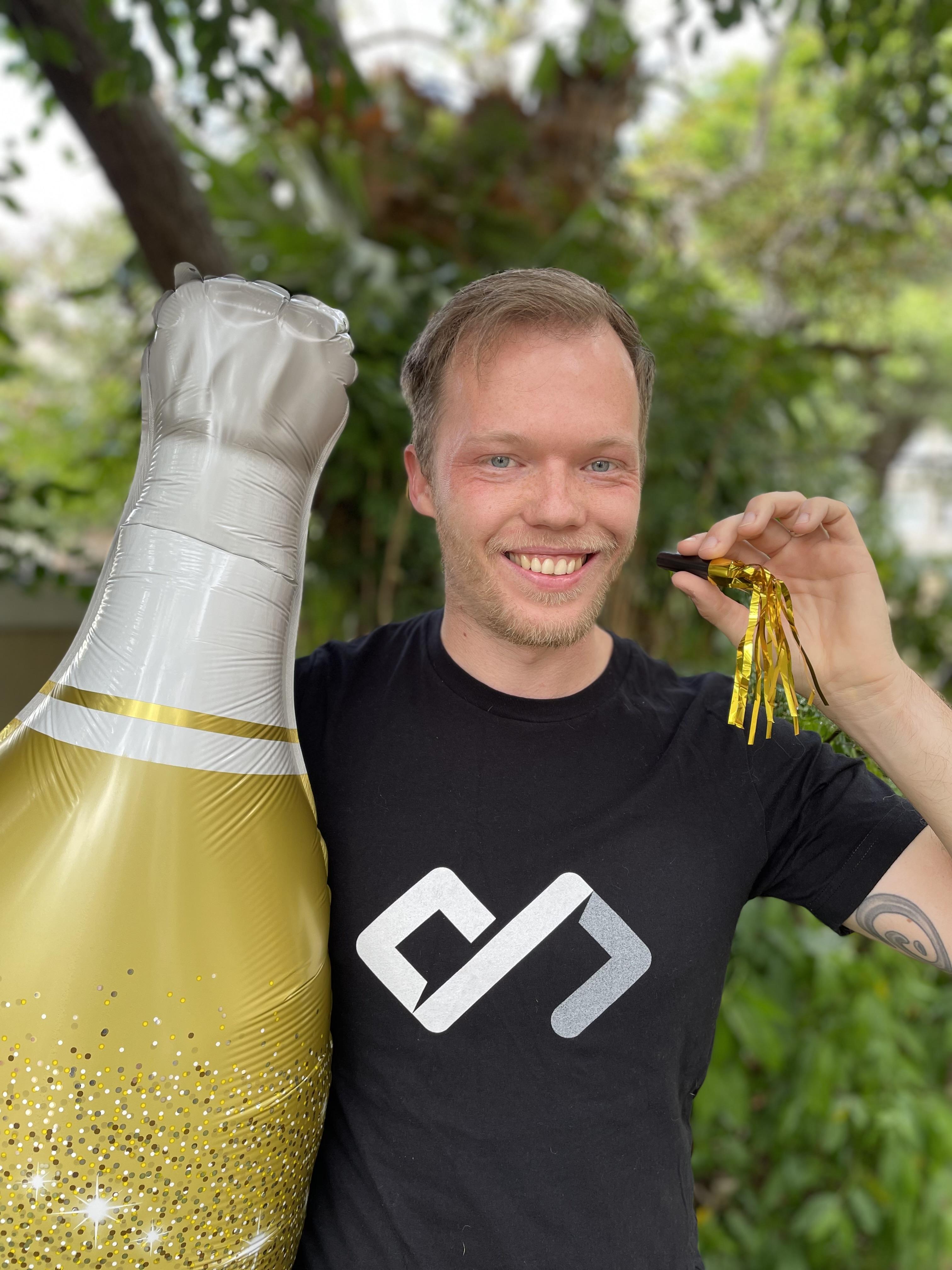 Chris celebrating new job